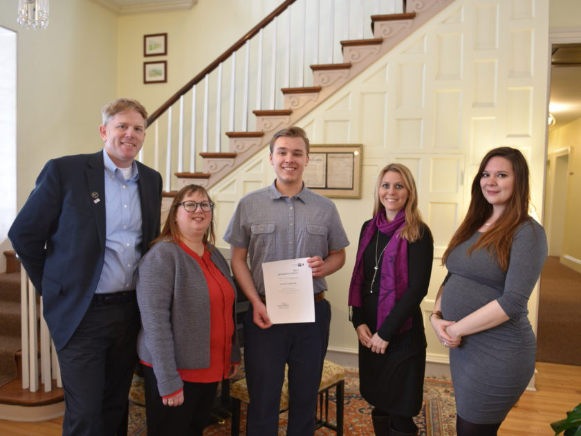 Brendan Troesch (center) poses with W&J professors and GABC representatives as they present him with his scholarship award.
