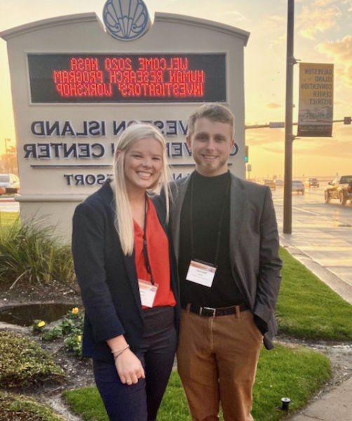 Brach Herzig and Julia Schaffer pose outside the NASA Workshop where they presented their research.