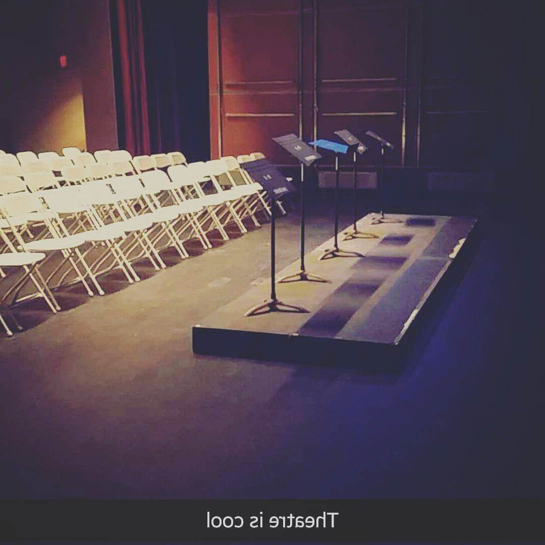 THEATRE SLAM - an image of the stage and lecterns