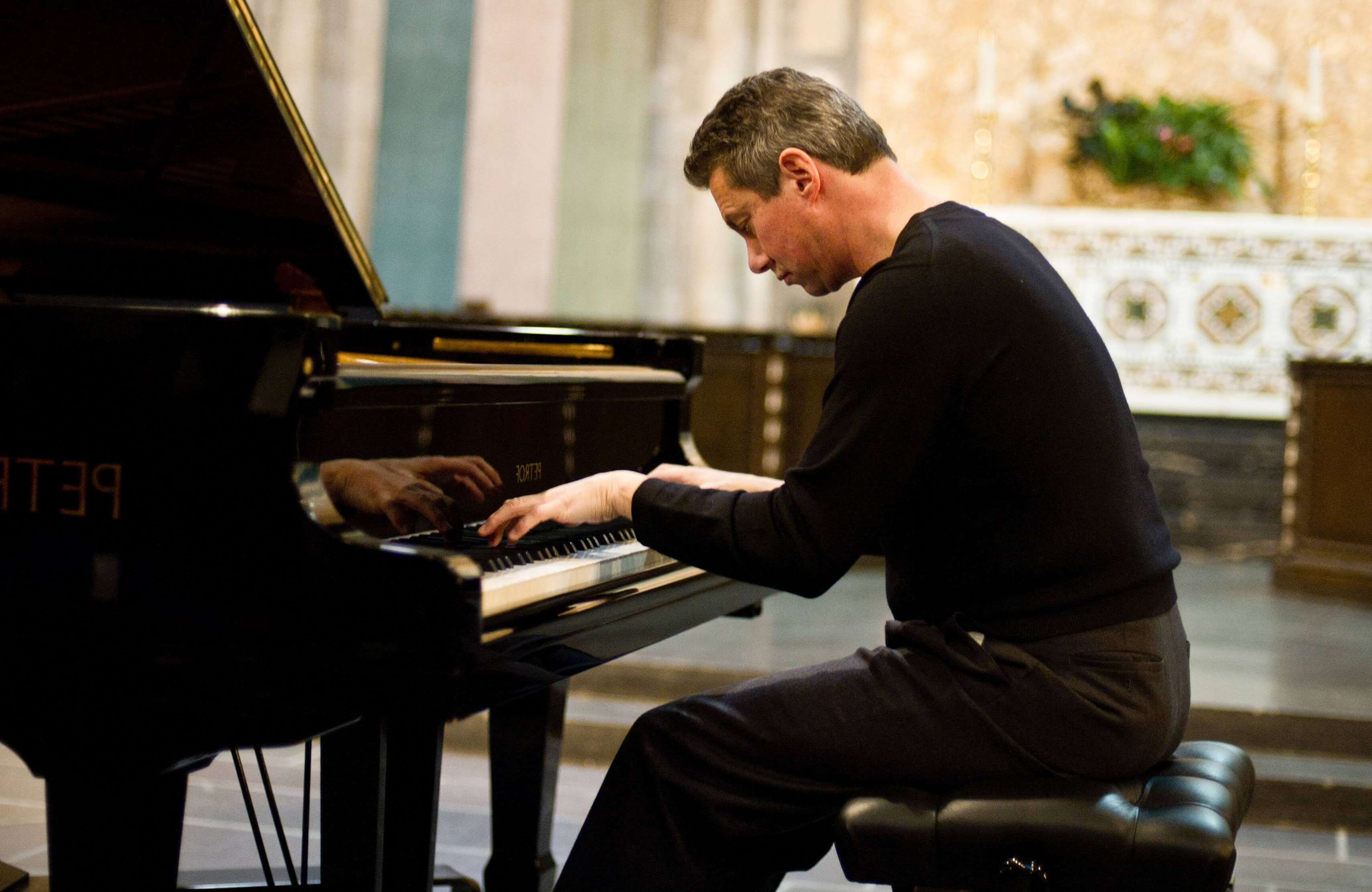 Musician Mark Valenti at a piano